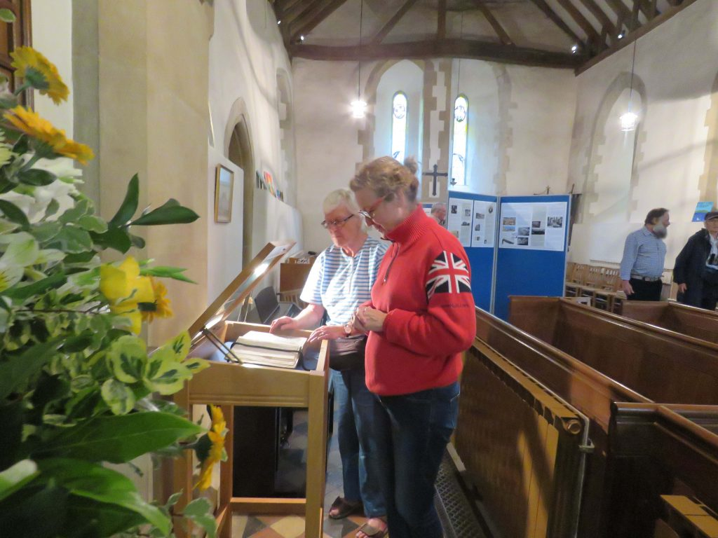 Visitors viewing the John Miller bible in St Lawrence's Church