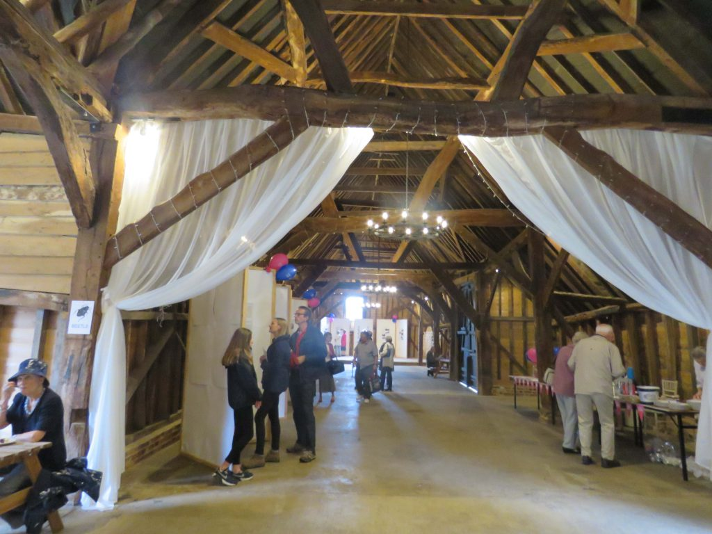 Visitors viewing the displays in the Tithe Barn, Little Bookham